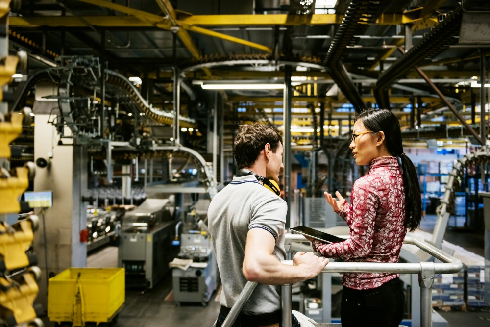 two people talking in industrial location
